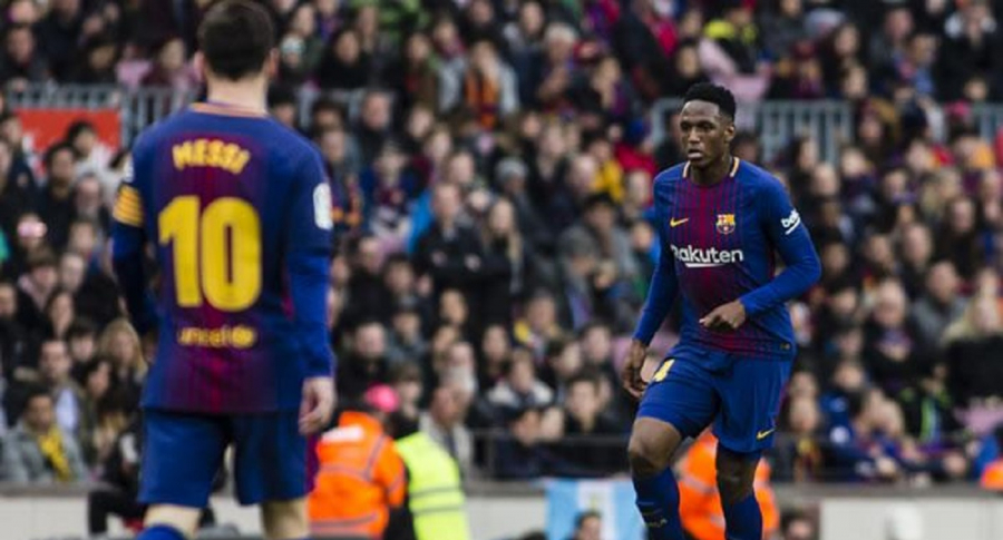 Yerry Mina y Lionel Messi