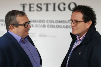 Rodrigo Londoño y Jesús Abad Colorado