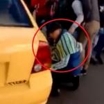 Alimentador pinchado y hombre pinchando llantas de taxi. Fotos: Twitter Blu Radio y captura de pantalla Twitter.