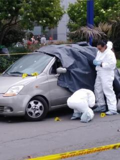 Mujer de conductor asesinado en Fontibón se alcanzó a bajar del carro, y esto contó