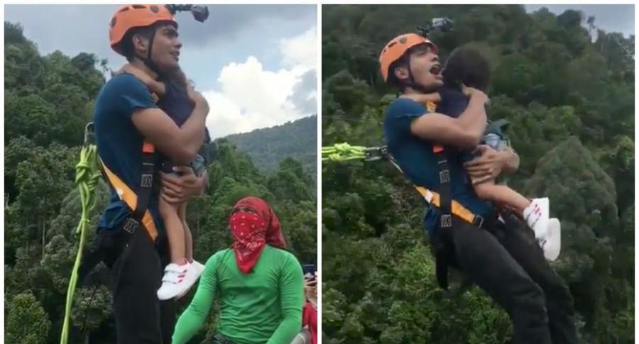 Hombre hace 'bungee jumping' con niña pequeña.