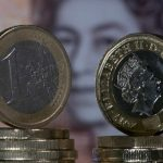 Moneda de Euro y moneda de Libra