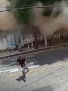 [Video] Vigilante corre por su vida al desplomarse edificio de 7 pisos detrás de él