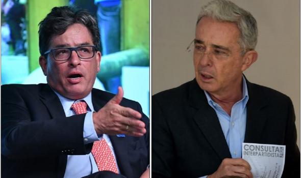 Alberto Carrasquilla y Álvaro Uribe