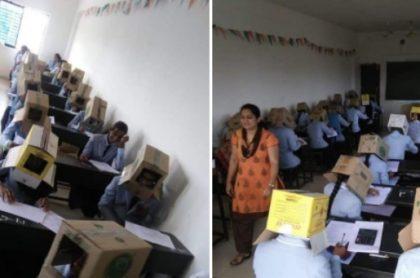 Estudiante usando cajas en la cabeza.