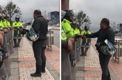 Motociclista orando con policías antes durante el paro nacional