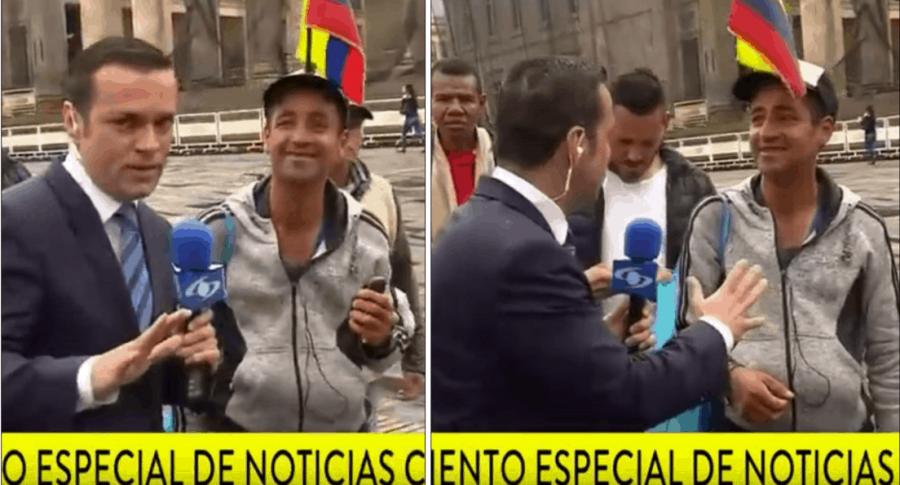 Juan Diego Alvira y el hombre de la banderita