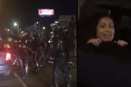 Manifestante subida a carro sin identificar Bogotá