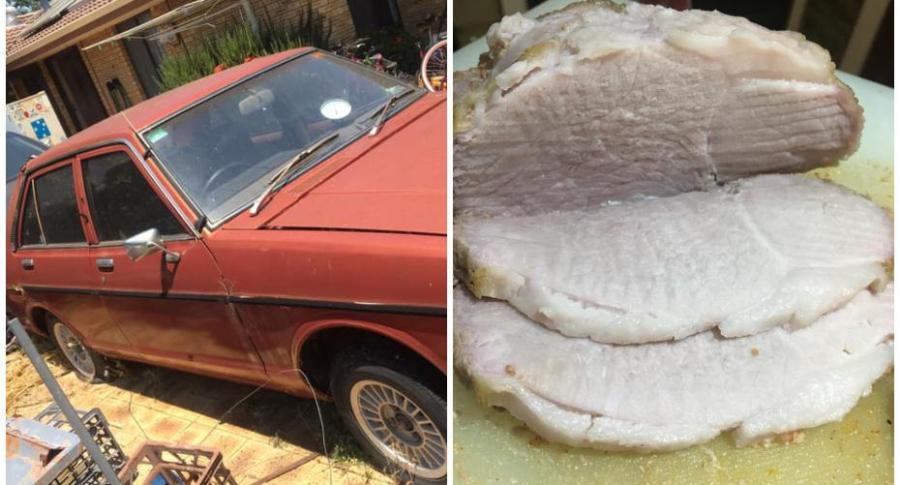 Hombre cocina carne en su carro.