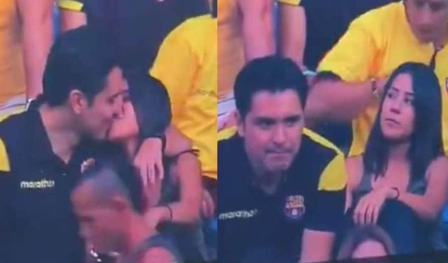 Pareja sorprendida en el estadio