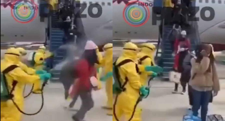 Chinos fumigando a viajeros