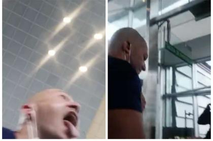 Hombre le tose a una mujer en la cara.