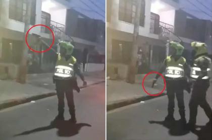 Policía apuntando con su arma de dotación