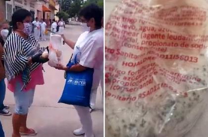 Madre de familia denunciando entrega de refrigerio dañado en Tocaima