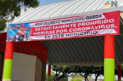 """Pancarta que prohíbe """"morirse de coronavirus""""."""