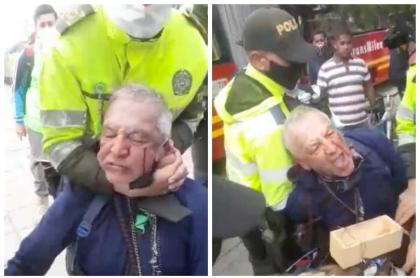Policías arrestan a vendedor ambulante.