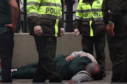 Mujer desmayada en Alkosto