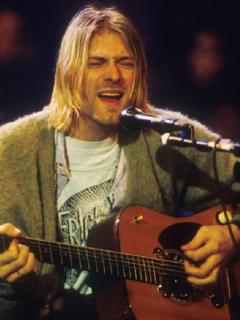 Guitarra de Kurt Cobain subastada por 6 millones de dólares / Kurt Cobain en 'MTV Unplugged' de 1993