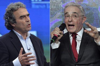 Sergio Fajardo y Álvaro Uribe, políticos.