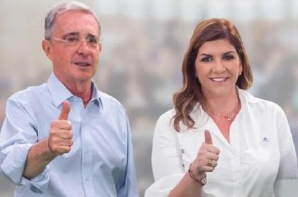 Imagen de Álvaro Uribe y Yenny Rozo en campaña