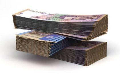 Fajos de billetes de 50.000, que ilustran nota de ganador de lotería de Medellín
