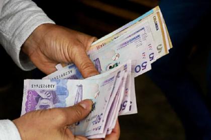 Imagen de dinero, que ilustra la nueva estafa usando pago del impuesto predial en Bogotá