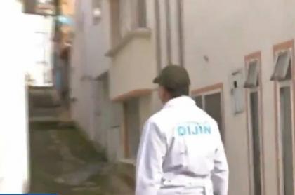Imagen de un Policía que investiga caso de familia muerta en Tunja