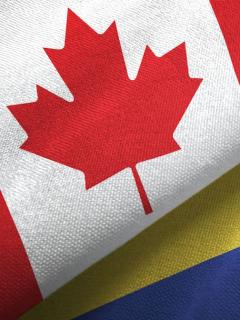 Banderas de Colombia y Canadá para ilustrar nota sobre requisitos para que los colombianos viajen a Canadá