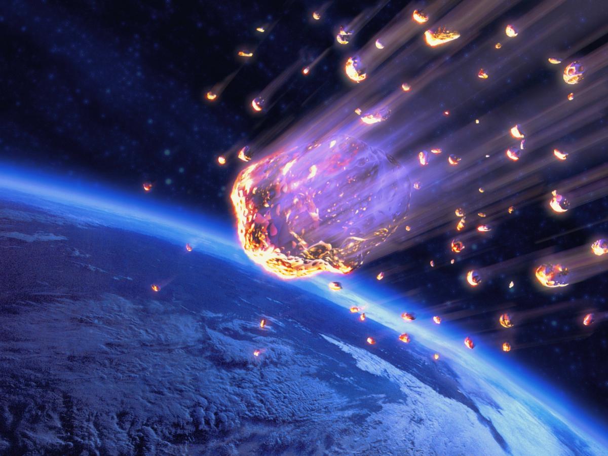 Imagen ilustrativa de un fragmento de esteroide en dirección a la tierra.