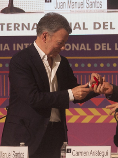 Juan Manuel Santos y Rodrigo Londoño ('Timochenko') en un evento en México.