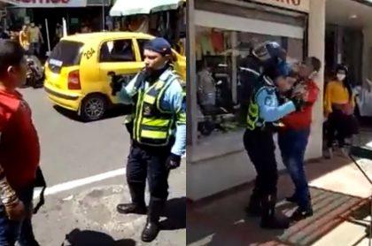 Captura de pantalla de la pelea entre un agente de tránsito y un motociclista, en Neiva