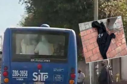 Imagen de la chaqueta y del bus del SITP en donde un ladrón asesinó a Wilfrido Murcia, un vigilante de 54 años que se opuso al atraco