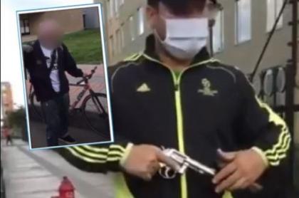Momento en que un hombre intimida con arma de fuego a dos jóvenes que pintaban un  grafiti en un conjunto en El Tintal, en Bogotá
