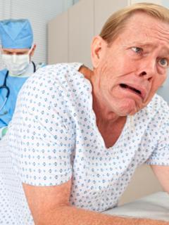 Examen de próstata por tacto rectal.