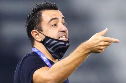 Xavi Hernández podría llegar al Barcelona; tiene quien lo lleve, confesó. Imagen de referencia del entrenador español en Catar.