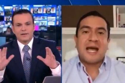 Juan Diego Alvira tratando de callar a congresista del Centro Democrático que no dejaba de hablar en debate