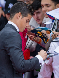ZURICH, SWITZERLAND - JANUARY 12: James Rodriguez of Colombia and Real Madrid signs autographs prior to the FIFA Ballon d'Or Gala 2014 at the Kongresshaus on January 12, 2015 in Zurich, Switzerland. (Photo by Philipp Schmidli/Getty Images)