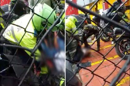 Imágenes de cuando los policías auxilian a los dos hombres que murieron en el ataque de sicarios en Bogotá