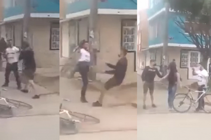Pelea entre un ciclista y un transeúnte en Bogotá. Mujer tuvo que defenderlo.