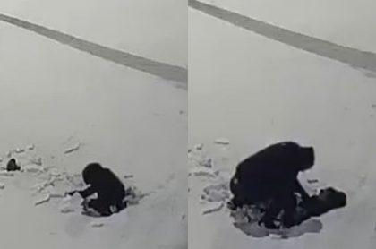 Capturas de pantalla de video viral en Rusia de niño de 5 años de Rusia que sobrevive al caer a la nieve desde un piso 12