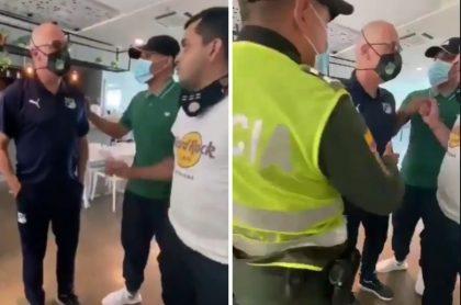 Alfredo Arias, técnico del Deportivo Cali, discutiendo con hinchas que lo apretaron