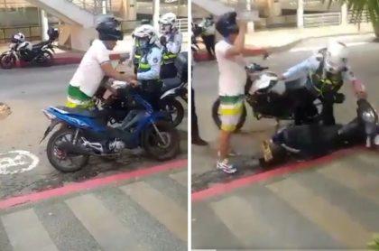 Hombre que golpeando con su casco a agente de tránsito que le inmovilizó la moto en Floridablanca, Santander