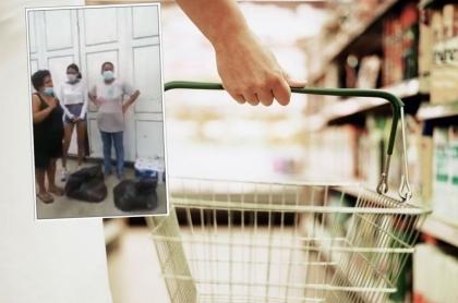 Imagen de la familia Torres cuando devuelve el mercado que saqueó de tienda en Cali, durante el paro nacional