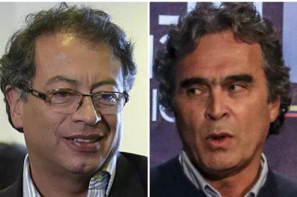 Gustavo Petro y Sergio Fajardo, quien tachó de populista al senador por la reforma tributaria que propuso