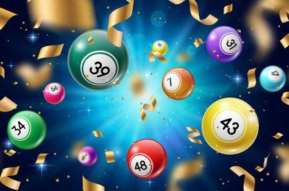 Bolas de juego de azar con fondo azul y con confeti ilustran qué chances jugaron anoche, resultados de Sinuano, Dorado, Antioqueñita y más de agosto 10 de 2021.