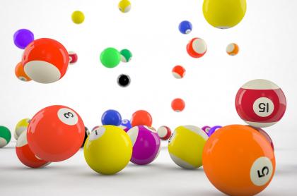 Bolas de colores y diversos números ilustran qué cayó Baloto anoche, números ganadores, premios y más.