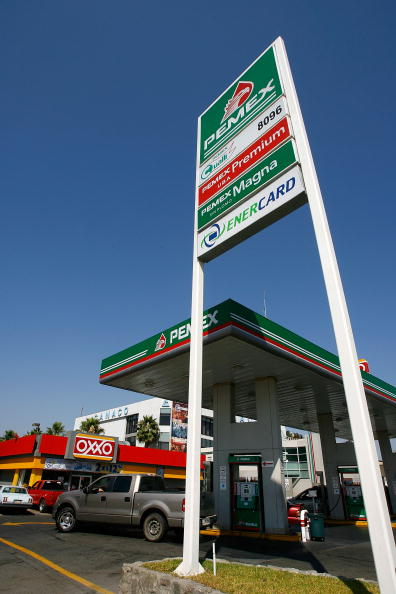 TIJUANA, MEXICO - JUNE 27: Car pull in and out of a Pemex gas station on June 27, 2008 in Tijuana, Mexico. With the cost of gasoline in California around $4.60 per gallon, many drivers are buying their fuel in Mexico for about $3.20. There is a price to pay for cheaper gas though. Mexican gas is formulated with more sulfur than California gas and that can damage the emission control equipment on US cars, causing them to fail emissions tests and leading to expensive repairs. In addition, unless a driver has other business in Mexico, part of their fuel savings will be burned up idling in a line that can easily last for hours to get back into the US. (Photo by David McNew/Getty Images)