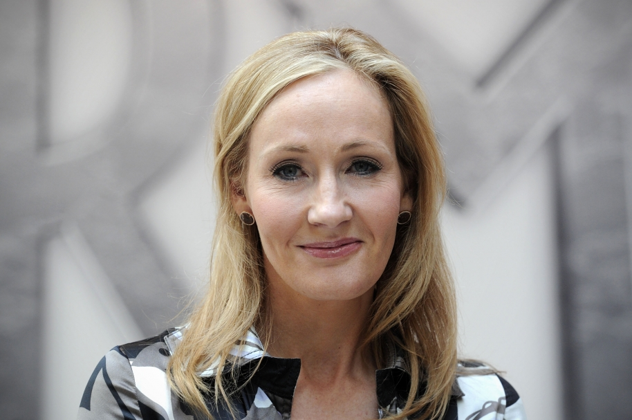 """(FILES) In a file picture taken on June 23, 2011 Harry Potter creator J.K. Rowling poses for photographers during the launch of her new project 'www.pottermore.com' in central London. Rowling said on June 11, 2014 she had donated 1 million GBP (1.2 million euros, 1.7 million USD) to the """"No"""" campaign in the Scottish independence referendum.  AFP PHOTO / CARL COURT / AFP / CARL COURT"""